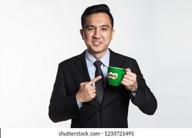 November 2018, Kuala Lumpur Malaysia - Man in suit holding a Milo mug, product of Nestle