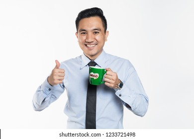 November 2018, Kuala Lumpur Malaysia - Asian man drinking Milo by Nestle with thumbs up