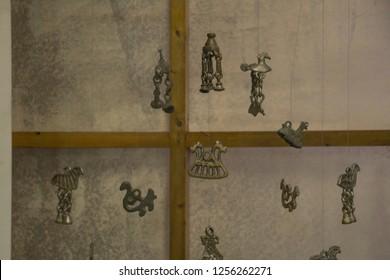 November, 2018 - Velsk. Pagan suspensions in the Velsky Museum. Russia, Arkhangelsk region