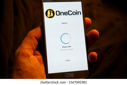 "NOVEMBER 2019 - BERLIN: the logo of the crypto-currency ""Onecoin"". According to US authorities, the company is a deceptive pyramid scheme."