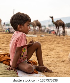 november 2019 pushkar,rajasthan portrait of a young little rajasthani boy crying during pushkar camel festival.selective focus on subject with added noise.
