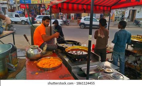 November 2020- Mahroli, Jaipur, India. Indian confectioner making sweet and crispy Jalebi. Delicious sweets shop outside of the road.