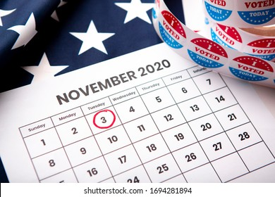 November 2020 presidential election date on calendar concept. Red white and blue colors and the american flag.