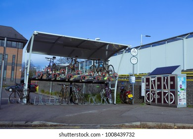 November 207, Reigate, Surrey, UK - cycle parking and Brompton folding bike hire automatic booth at railway station
