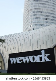 November 22, 2019,Shanghai: wework logo with l'avenue shanghai office building background