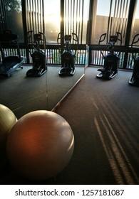 November 22,2018 Fitness room, Eastin hotel,Chiangmai,Thailand. Mirrow reflects the reflection of a ball and treadmill equipments.