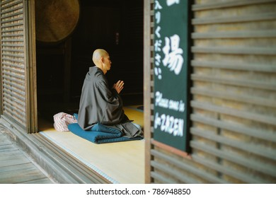 NOVEMBER 23, 20017. KAMAKURA, JAPAN.A Japanese monk practicing zazen -  a form of zen meditation. The Japanese letters point out the meditation room name.