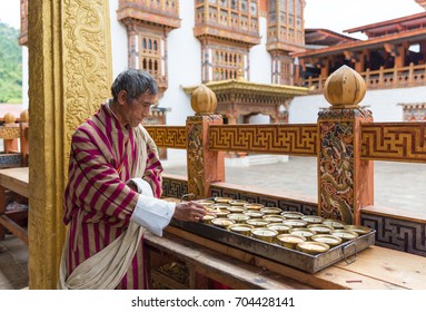November 23, 2013 - Punakha Dzong, Dalakh, India: A man who working in Punakha Dzong was lighting the candles.