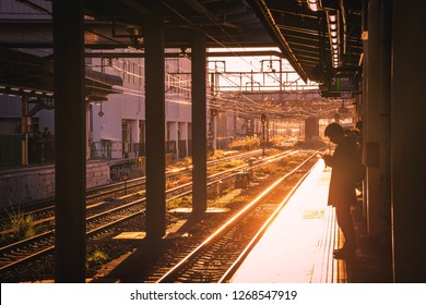 November 23, 2018 - Machida, Tokyo Japan, The morning life cycle of salaryman or office worker in Japan, waitng the train/commute for going to work. Taken in high key mood and tone.