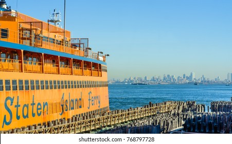 November 24 2017 : View of Staten Island Ferry docked at St. George Ferry Terminal on Staten Island New York with the background of Jersey City .