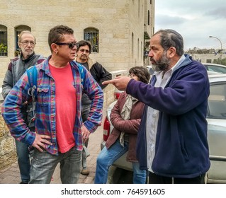 November 25, 2017. Noam Arnon (right) - writer and politician and historian Mikhail Tuval (left) conducting a scientific dispute on Hebron street