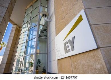 November 25, 2018 San Jose / CA / USA - EY logo next to the entrance to their offices in downtown San Jose, south San Francisco bay area