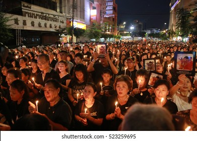 November 26, 2016. Thai mourners wearing dress black hold portraits of late Thai King Bhumibol Adulyadej at Streets Chinatown, in Bangkok, Thailand.