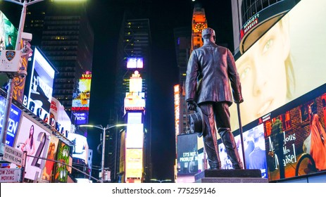 November 26 2017 : View of statue of George m. Cohan and theaters neon advertising of News at times square New York at night.
