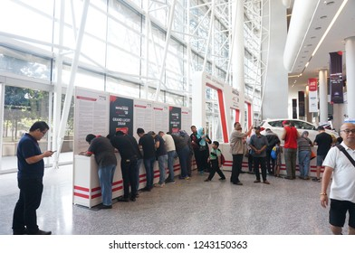 November 27, 2018 - KL, MALAYSIA. Local visitors queuing at local ticketing counter at local car exhibition centre in Malaysia.