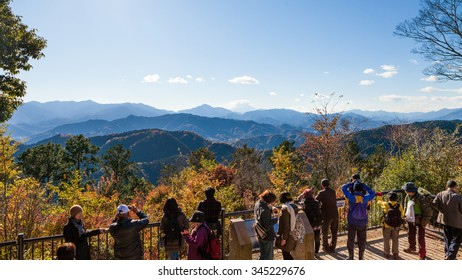November 27th, 2015, Mount Takao, Japan. People on the summit of Mount Takao enjoying the view of Mount Fuji on a sunny Autumn day.