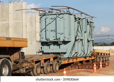 NOVEMBER 29, 2014 : NAN - THAILAND : Under loading heavy power transformer with heavy truck at site of switchgear to be installed.