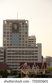 November 29, 2016. A large portrait of the late King Bhumibol Adulyadej the Great is on the building of Siriraj Hospital. Vertical orientation. Bangkok, Thailand.