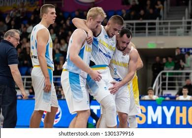 NOVEMBER 29, 2018 - ZAPORIZHIA, UKRAINE: Teammates helping Oleksandr Kobets to leave court after getting terrible anterior cruciate ligament injury. FIBA World Cup 2019 Qualifiers Ukraine-Slovenia