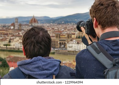 November 3, 2018, Tuscany, Italy: two men stand on Piazzale Michelangelo, one of them looks at the panorama of Florence, and the other is taking pictures.