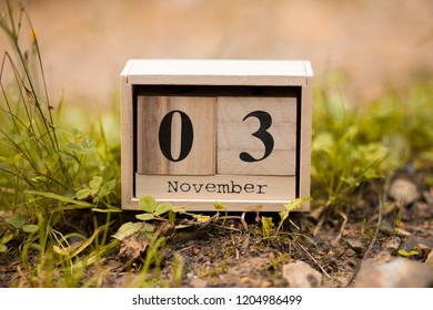 November 3rd. Day 3 of November set on wooden calendar on wooden plank background. Autumn time