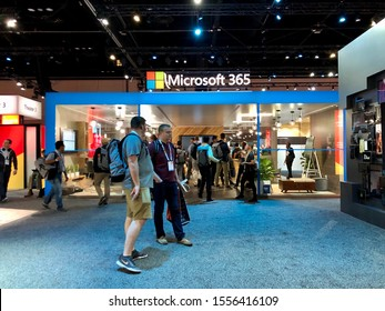 November 6, 2019 Microsoft Ignite attendee walks passed by Microsoft 365 booth.