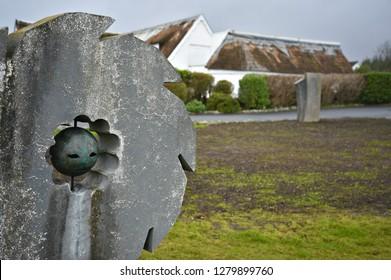 November 8, 2018. Millstone bronze sculpture in Ceardlann Spiddal Craft Village Galway County, Ireland.
