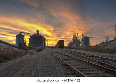 NOVEMBER 9, 2015: WESTERN KANSAS: GRAIN SILOS/Elevator for storing Grain  - Grain storage facilities hold grain from local farmers. Being close to the train tracks for convenience in shipping.