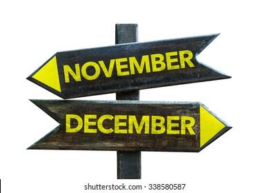 November December signpost isolated on white background