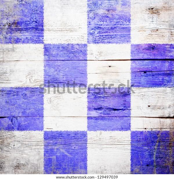 November, international maritime signal flag painted on grungy wood plank background