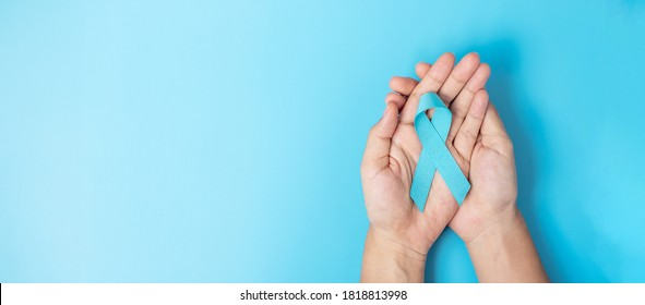 November Prostate Cancer Awareness month, Man holding light Blue Ribbon for supporting people living and illness. Healthcare, International men, Father, World cancer day and world diabetes day concept