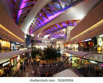 November19, 2017. customers visit well and impressive lighting design inside HUAFA commercial Plaza, huge complex shopping mall with restaurants and outdoor musical fountain show in ZHUHAI city, CHINA