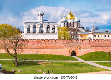Novgorod kremlin wall and church on sunny day. Blue cloudy sky in background. Travel in Russia.