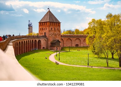 Novgorod kremlin wall and tower on sunny day. Blue cloudy sky in background. Travel in Russia.