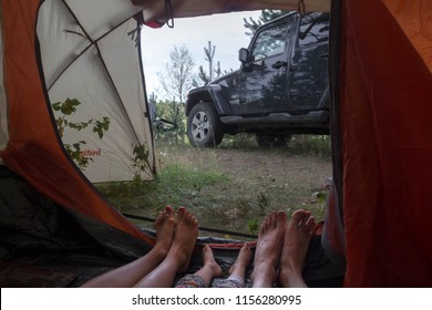 Novgorod region, Russia, August 3, 2018: view from the tent on the black jeep Wrangler Sahara.. Wrangler is a compact four wheel drive off road and sport utility vehicle