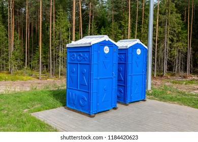 Novgorod region, Russia - August 7, 2018: Mobile public toilets at the Russian highway number M11 in summer day