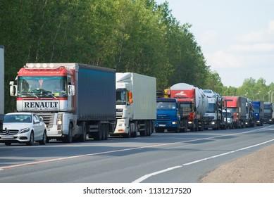 "NOVGOROD REGION, RUSSIA - JUNE 27, 2018: A jam of trucks on the M10 ""Russia"" highway"