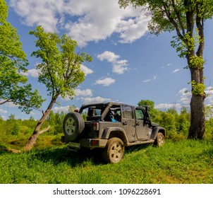 Novgorod region. Russia. May 19, 2018: A Jeep Wrangler on the banks of the Luga river