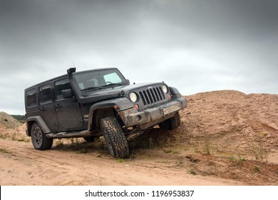 Novgorod region. Russia, September 22, 2018: black Jeep Wrangler Sahara on the Bank of a forest river. Wrangler is a compact four wheel drive off road and sport utility vehicle