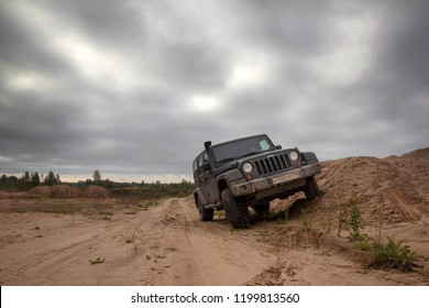 Novgorod region. Russia, September 22, 2018: black Jeep Wrangler Sahara on a sand quarry. Wrangler is a compact four wheel drive off road and sport utility vehicle