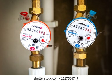 Novgorod, Russia - August 17, 2017: Water meters. Counters of hot and cold water