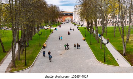NOVGOROD, RUSSIA - MAY 2, 2014: People walking at Novgorod Kremlin with wall and arch in background.