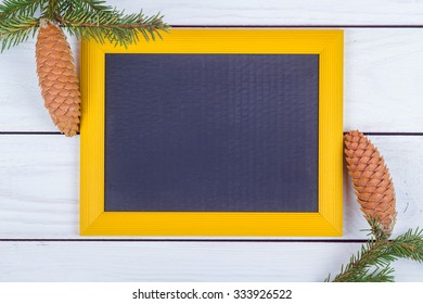 Novgorodny frame and fir-tree jewelry on white boards