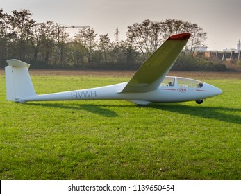 Novi Ligure, Alessandria, Italy - November 12 2011: side view of ASK-21 sailplane (glider) on grass runway of local airfield. Gliders fly (soar) without engine