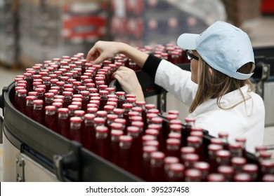NOVI LIGURE, ITALY - 21 NOVEMBER 2012: Bottles of Camparisoda travel along the production line at Davide Campari-Milano SpA's factory.