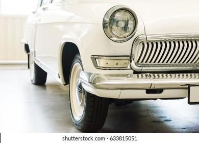 NOVI PETRIVTSI, UKRAINE - APRIL 2017: Classic car with closeup on headlights. Vintage vehicle front detail. The Museum of Old Vehicles in residence of ex-president of Ukraine Viktor Yanukovich