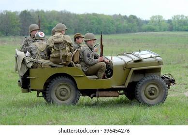 Novi Petrivtsi, Ukraine - May 13, 2007. Military history club members reenacting USA recon patrol ride Willys MB jeep