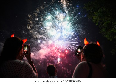 Novi Sad, Serbia - 04 July 2019: Visitors watch firework during Opening ceremony at Main Stage at Exit festival. The 19th Exit festival with the theme of Tribe started at Petrovaradin fortress