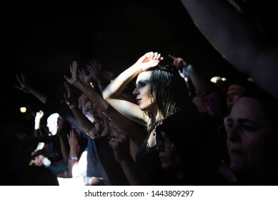 Novi Sad, Serbia - 04 July 2019: Beautiful girl and other fans in the first raw during the Cure performing at Main Stage at Exit Tribe festival at Petrovaradin fortress in Novi Sad, Serbia