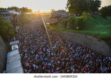 Novi Sad, Serbia - 04 July 2019: Visitors of Exit Festival dance at Dance Arena during sunrise. The 19th Exit festival with the theme of Tribe started at Petrovaradin fortress on 4th of July, 2019.